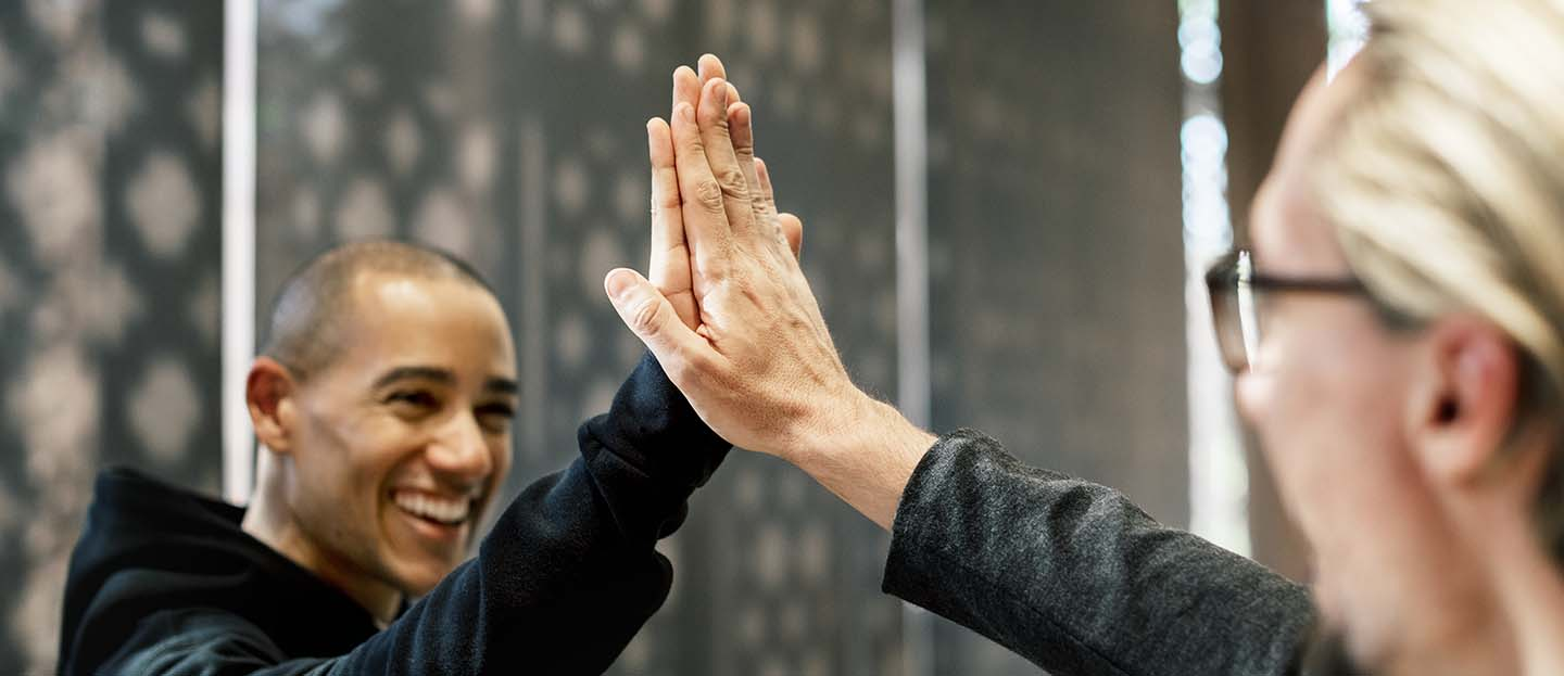 Colleagues giving a high five
